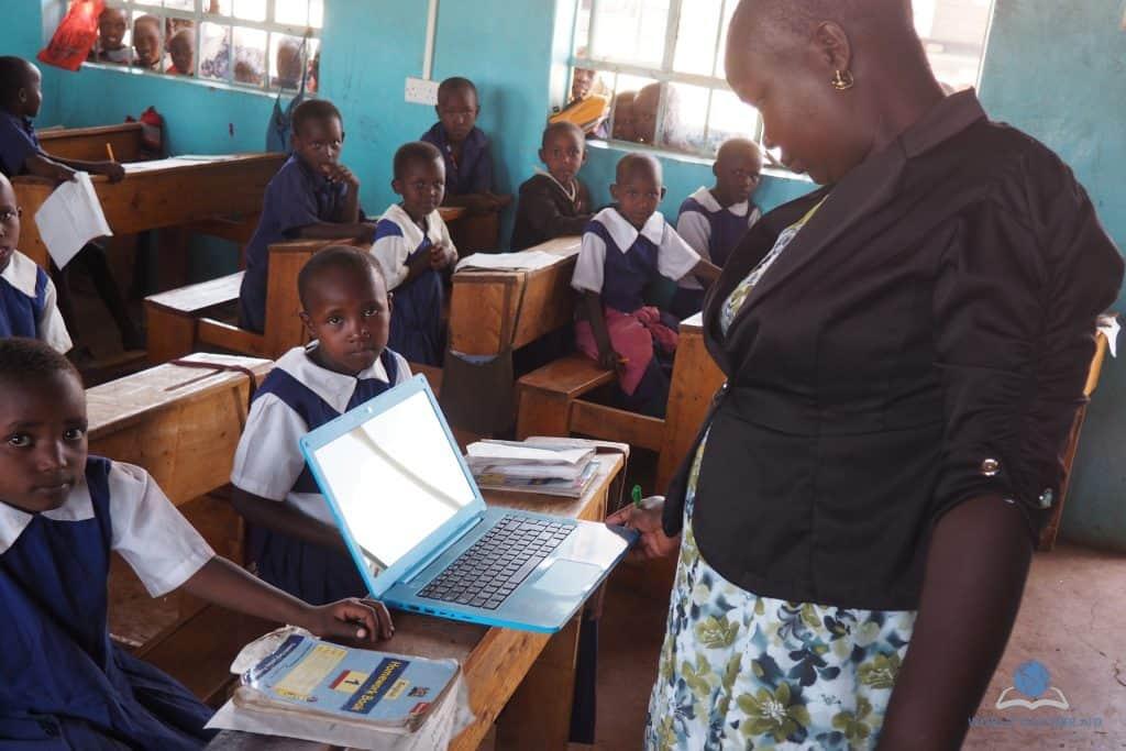 Teacher with laptop in Kenya primary school